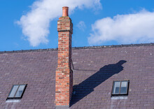 Tall Chimney On Sloped Roof