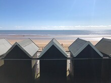 Old Fashioned Beach Huts Facing The Ocean