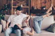 Portrait Of Attractive Cheerful Couple Soulmates Sitting On Divan Enjoying Having Fun Talking At Loft Style Interior Home House Indoor