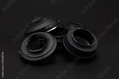 Obraz przejściówka pierścień adaptador fotografia osprzęt - fototapety do salonu