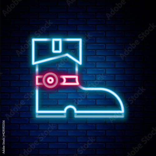 Glowing neon line Leather pirate boots icon isolated on brick wall background Wallpaper Mural