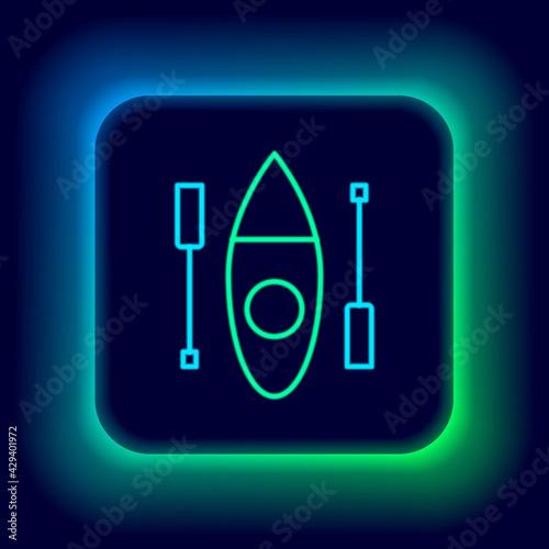 Fotografija Glowing neon line Kayak and paddle icon isolated on black background