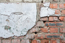 Weathered Red Brick Wall For Texture Or Background, Rough Aged Brickwork, Masonry With Remnants Peeling Cement Plaster
