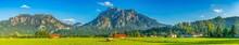 Schwangau Village Panorama In Bavaria, Southern Germany With Neuschwanstein Castle And Tegelberg Mountain Peak