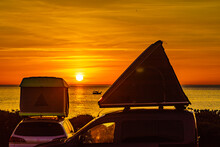 Cars With Roof Top Tent Camp On Beach