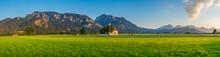 St. Coloman Church With Telberg Mountain Peak In Schwangau. Southern Germany