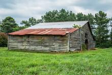 Abandoned Barn In A Farm Field