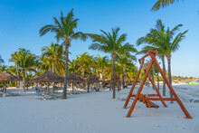Beach With A Empty Swing At The Morning In Cancun