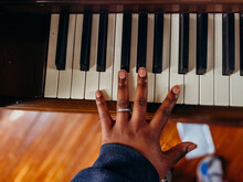 Black Hand With Ring Playing Piano Keys