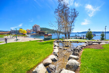 A Small Stream Flows Into The Lake With The Downtown And Tubbs Hill In View In Coeur D'Alene, Idaho, USA