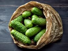 Fresh Green Cucumbers In Paper Bag