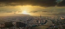 Aerial View Of Ho Chi Minh City Under Dramatic Sunset Sky