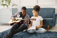 African Father Teaches His Daughter To Play Guitar