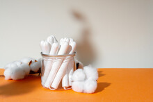 Glass Jar With Hygienic Tampons And Cotton Flower