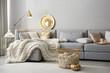 Leinwandbild Motiv Cozy living room interior with knitted blanket on comfortable sofa