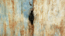 Background Of Very Old Metal Rusty Grey Garage Door With Handle And Barn Lock