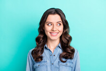 Photo Of Shiny Adorable Young Lady Dressed Denim Shirt Arm Smiling Looking Empty Space Isolated Teal Color Background
