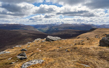 Distant Views Of Meall Garbh, An Stuc And Ben Lawers From The Mountain Summit Of Cam Chreag With Glen Lyon Below In The Winter Scottish Highlands, UK Landscapes.