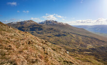 The Mountain Summits Of Ben Lawers, Meall Corranaich And Beinn Ghlas From Below Meall Nan Tarmachan With Loch Tay Off To The Right In The Winter Scottish Highlands, UK Landscapes.