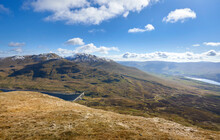 The Mountain Summits Of Ben Lawers, Meall Corranaich With Lochan Na Lairige Below From Meall Nan Tarmachan With Loch Tay Off To The Right In The Winter Scottish Highlands, UK Landscapes.