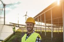 People Working For Solar Panels And Wind Turbines - Renewable Energy Concept - Focus On Man Face