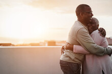 Happy African Couple Dancing Outdoors At Summer Sunset - Focus On Man Face