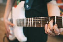 Teenager Playing Electric Guitar At Home