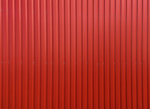 Building Wall Clad In Red Plastic Siding