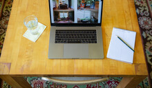 Laptop On Wooden Table With Presentation