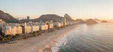 Panoramic Aerial View Of Copacabana Beachfront And Sugarloaf Mountain At Sunrise In Rio De Janeiro, Brazil.
