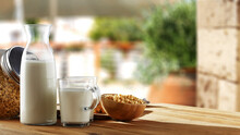 Fresh Cold Milk On Table And Free Space For Your Decoration