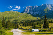 Caravan In Summer Mountain Landscape, Alps, Italy