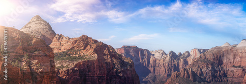 Panoramic Aerial perspective American landscape view of Mountains and Canyon. Dramatic Colorful Summer Sunset Artistic Render. Taken in Zion National Park, Utah, United States. Nature Background