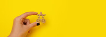 Wooden Carriage In Hand Over Yellow Background, Vintage Transport, Panoramic Mock-up