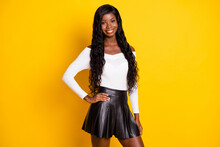 Photo Portrait Of Black Skinned Woman Wearing Sexy Outfit Leather Mini Skirt White Top Isolated On Vivid Yellow Color Background