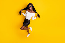 High Angle View On Cheerful Black Skinned Woman Making Tails With Long Hair Stylish Outfit Isolated On Vibrant Yellow Color Background