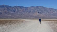 Man Walking At Badwater Basin, Death Valley National Park, California, USA. Static