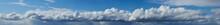 A Beautiful Blue Sky Panorama And Streaky Clouds Like Heaven. Summer Blue Sky