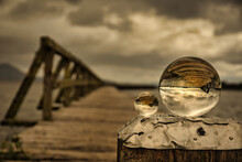 Arty Abstract View Of The Old Wooden Tokaanu Wharf, Lake Taupo In Moody Cloudy Rainy Weather Featuring Two Crystal Balls