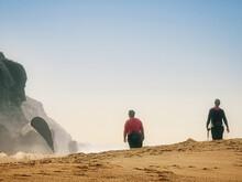 Two Women Walking On The Beach