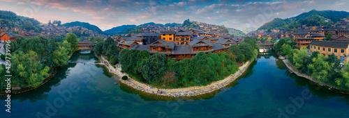 Fototapeta Dusk scenery of Qianhu Miao village in Xijiang, Qiandongnan, Guizhou Province, China obraz