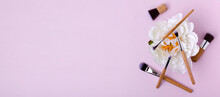 Top View Of Pink Background And White Peony, Professional Makeup Brushes On It.Banner For Ad