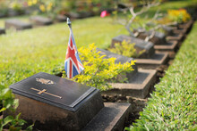 Graveyard With Gravestone With Green Grass And Union Jack Flag. No People