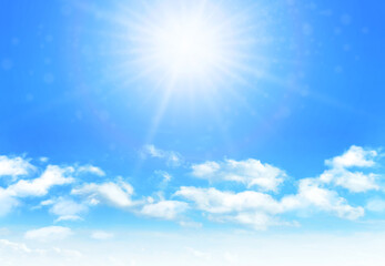 Sunny day background, blue sky with white cumulus clouds and glaring sun
