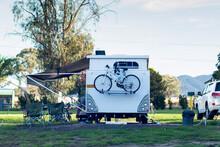RV Caravan Camping At The Caravan Park. Camping Vacation Travel Concept