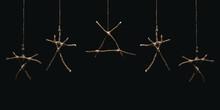 Witchcraft Sticks Symbols. Magic Occult Symbol. Many Totems Hanging On Dark Background. Mysticism And Black Magic Concept.