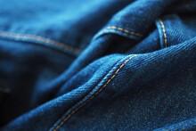 Close-up Detail Of Seam On Blue Denim Jeans