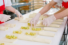 Workers Of The Confectionery Factory Prepare Desserts With Filling.