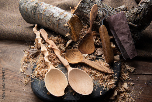 Slika na platnu wooden spoon carver at work with hand tools