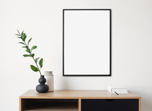 Blank Picture Frame Mockup On White Wall. Artwork In Design Interior. Modern Scandinavian Style. Home Staging And Minimalism Concept